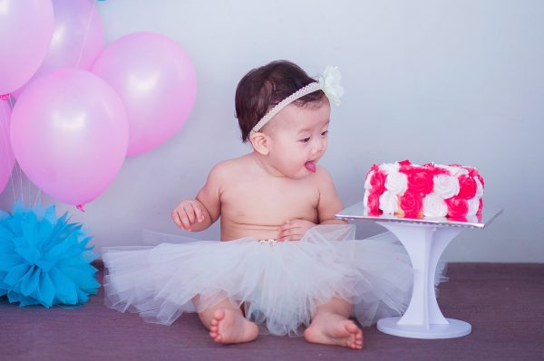 A baby girl wearing a ballerina skirt with white headband - New Moms Asia SuperMomGlobal