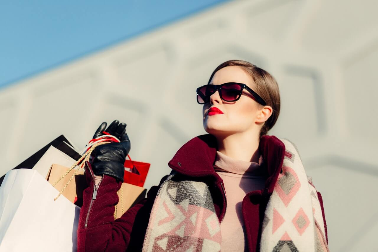 A girl wearing sunglasses while holding shopping bags - Fashion and Beauty Mummies Community SuperMomGlobal